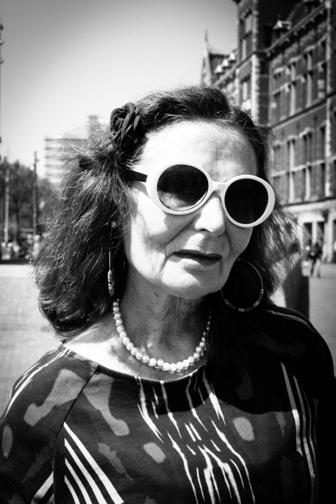 Women with the white sunglasses