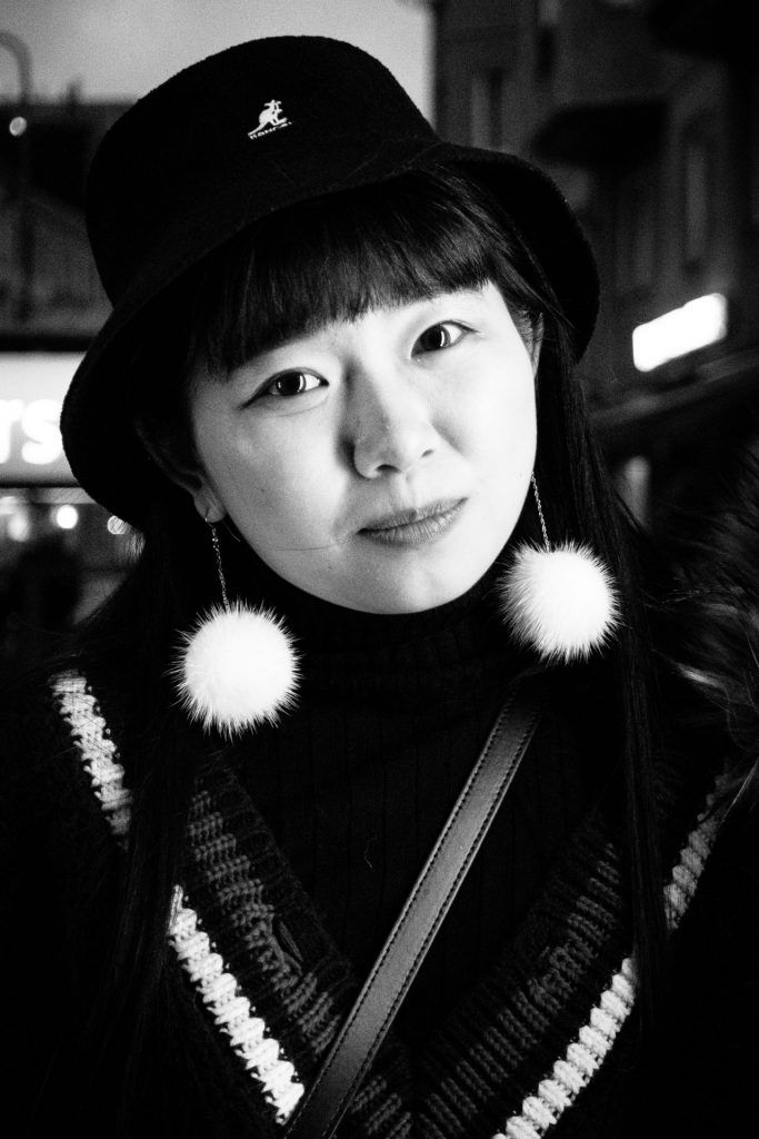 Chinese girl with the white pompom earrings