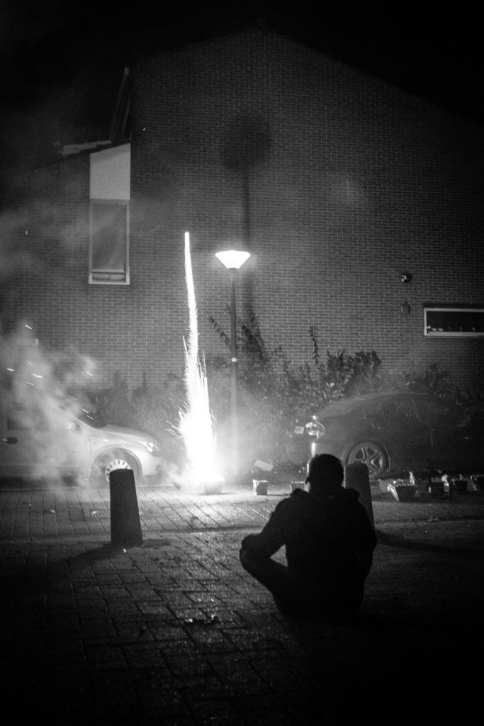 Rocket Man ... Just after the start of 2018 this young man watched how his rocket arrows soar through the sky to ignite with a flash and a bloom of fireworks. 1-1-2018, Hoorn, The Netherlands